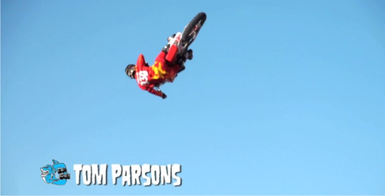 Tom Parsoms wins the Dirt Shark Biggest Whip Contest by throwing his motocross bike upside down
