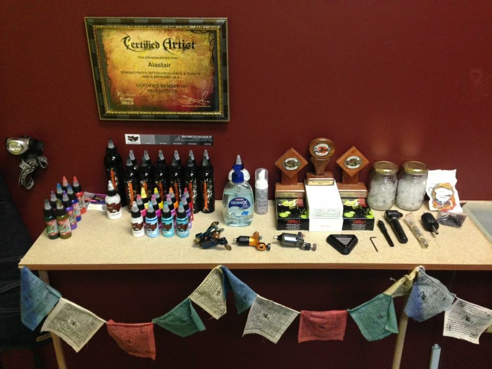 Alastair Magee setup and ready to tattoo an eager client