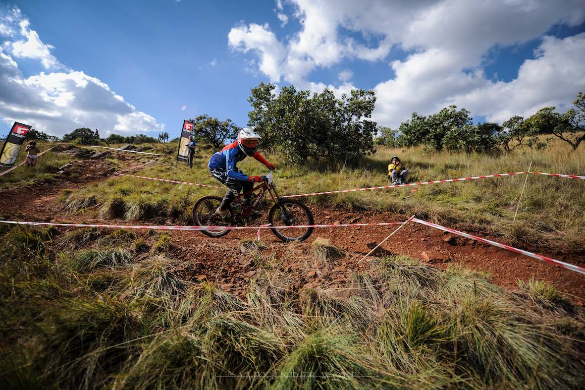 Kelvin Purchare racing his way to 2nd place in the Downhill MTB division at the Dustin Rudman Invitational