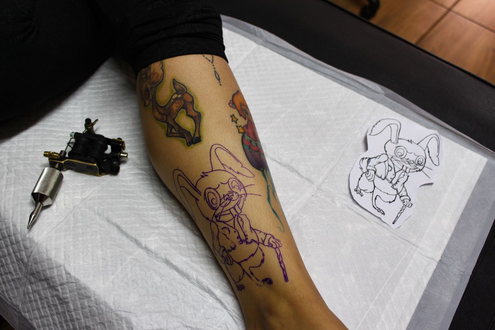 laying down the stencil and getting ready to tattoo