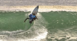 Michael February surfing his way to victory in the Vans Surf Pro Classic Men's division