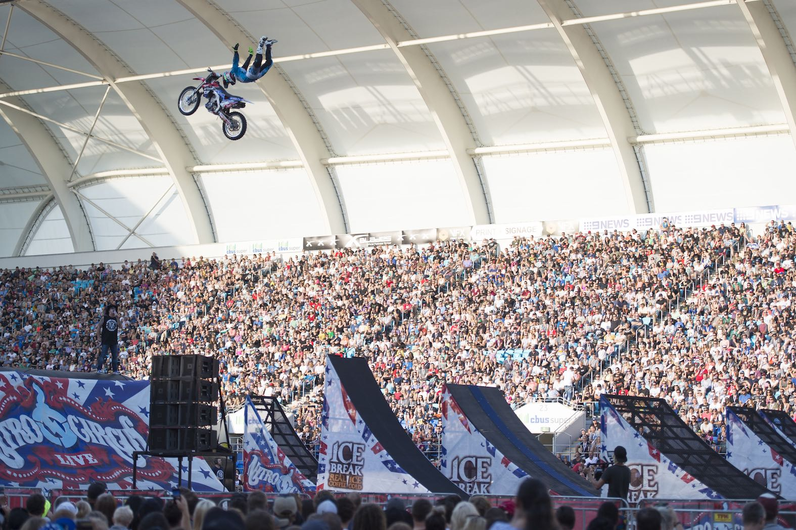 FMX rider Harry Bink flying high above the Nitro Circus Love fans