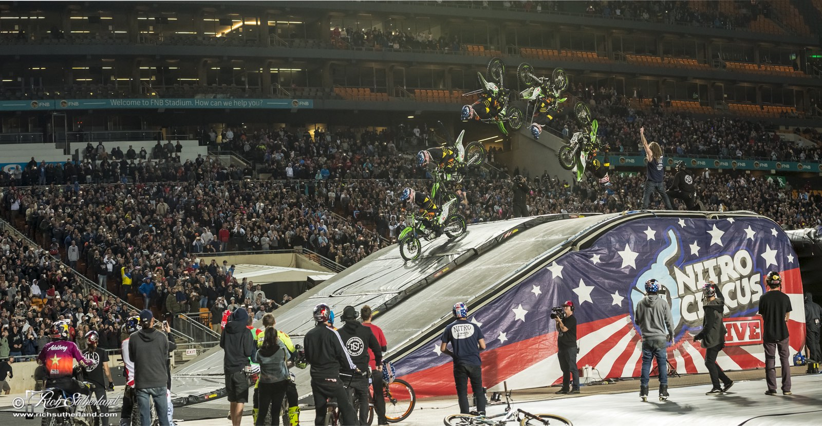 Bruce Cook landing a backflip on a dirt bike at Nitro Circus Live
