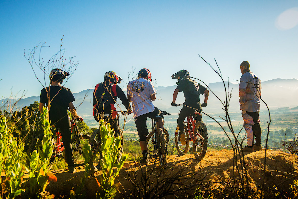 Riders getting ready to drop into the 2018 DarkFEST course