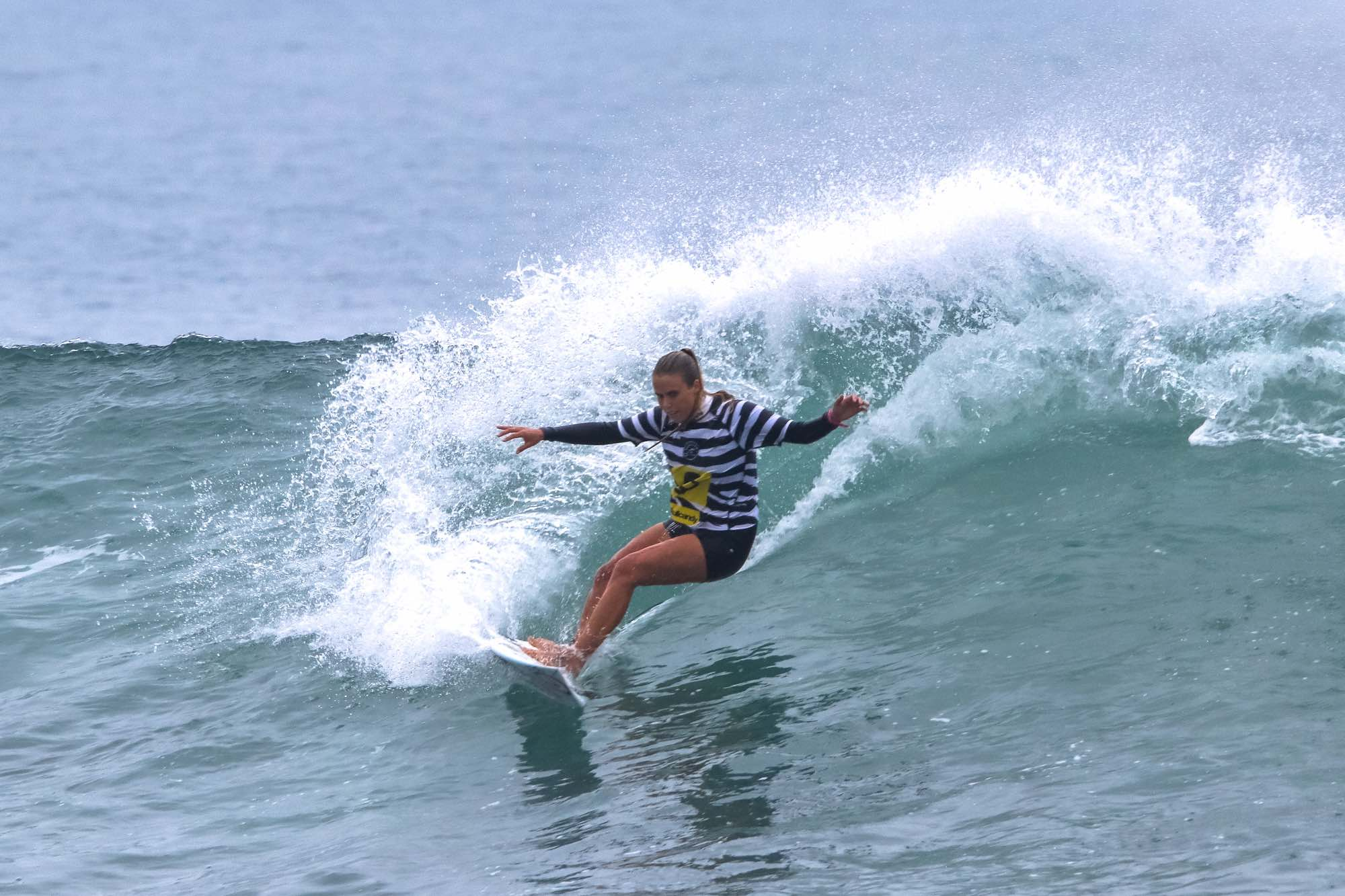 Nicole Pallet surfing her way to victory at the Mitchum Buffalo City Surf Pro
