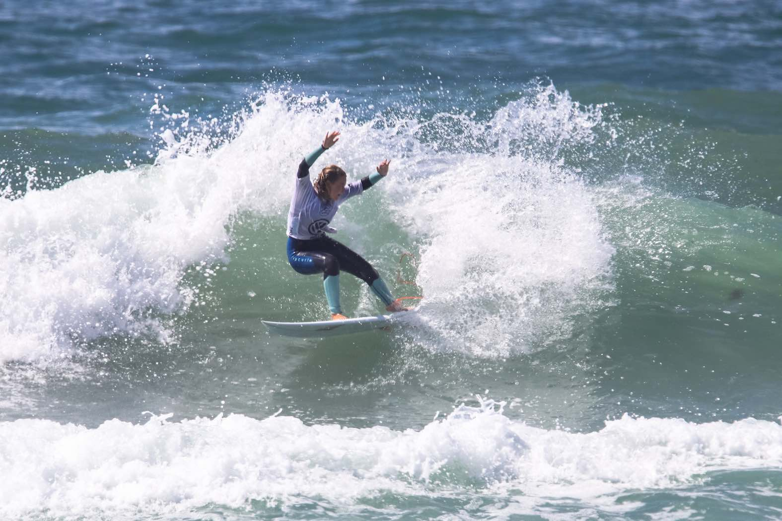 Kai Woolf surfing her way to victory at the Volkswagen Nelson Mandela Bay Surf Pro