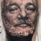 Realistic tattoo work by Adam Megens