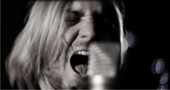 Knave lead singer performing in their new South African music video