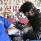 Moog tattooing on of his clients at Otherworld Tattoos and Piercings