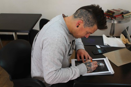 Thus Uys preparing the artwork for the tattoo