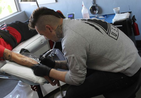Thys Uys getting started on the new tattoo