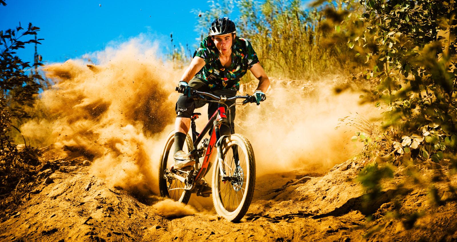 Theo Erlangsen smashing the dusty berm on his YT Capra