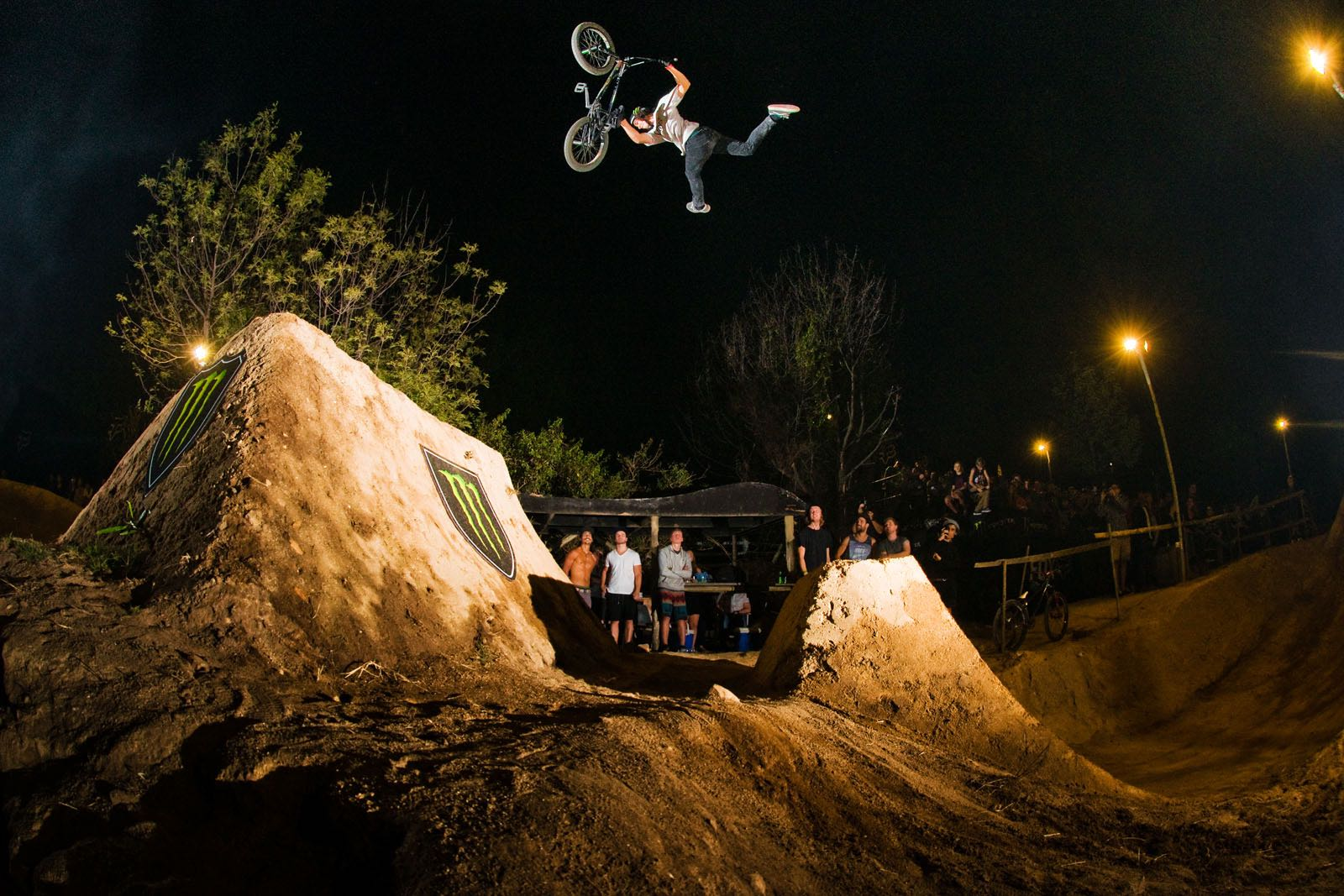 BMX riders competing at The Night Harvest BMX and MTB Dirt Jump competition