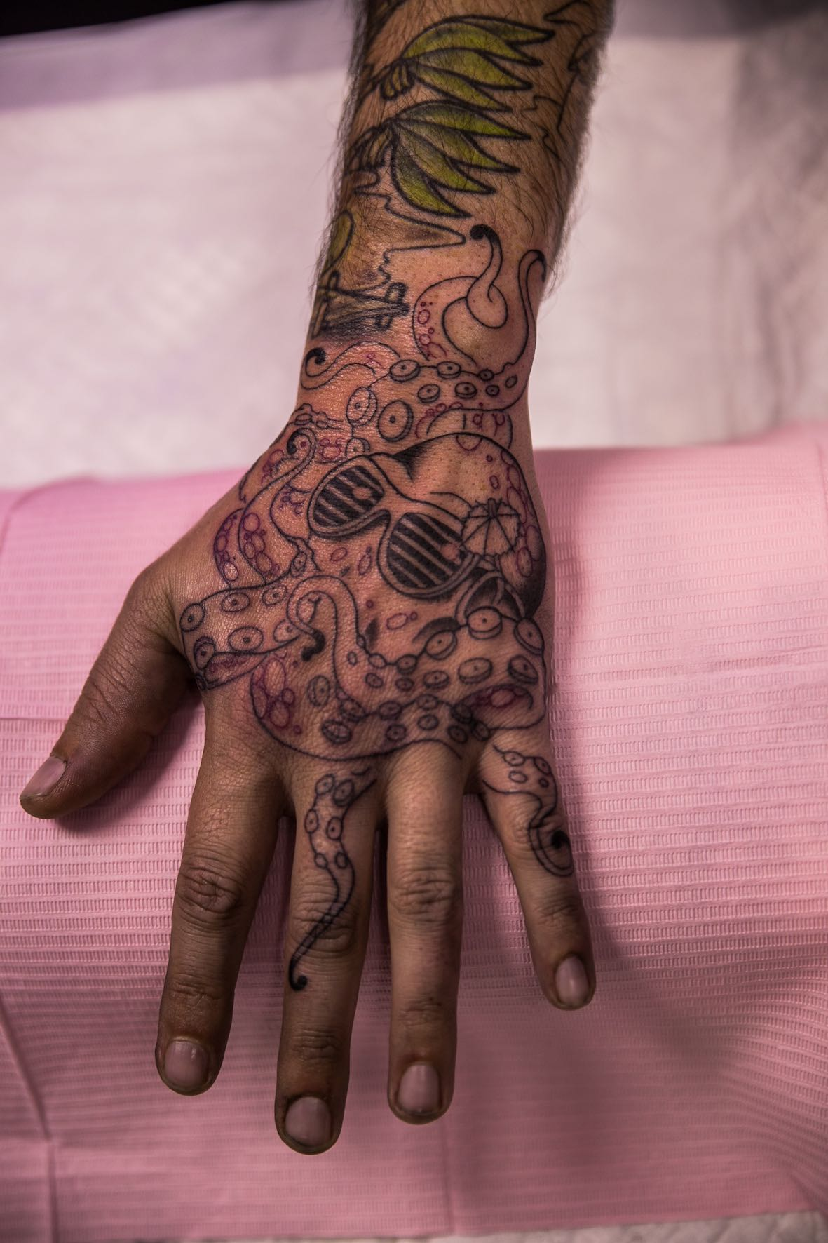 Near complete hand tattoo done by Chelsea-Rae Marsh