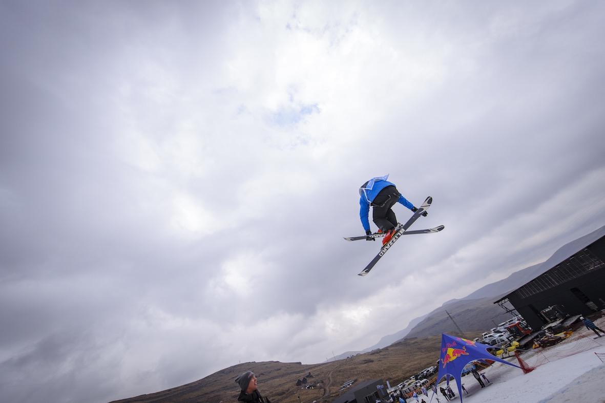 Dimonik Schalper skiing in the Ultimate Ears Winter Whip slopestyle contest