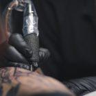 Adam Megens hard at work in his Edenvale tattoo studio