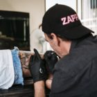 Christo Kleynhans tattooing out of Stay Gold Tattoo Co