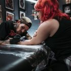 Daniel Forster tattooing a client at Heart & Hand Tattoo