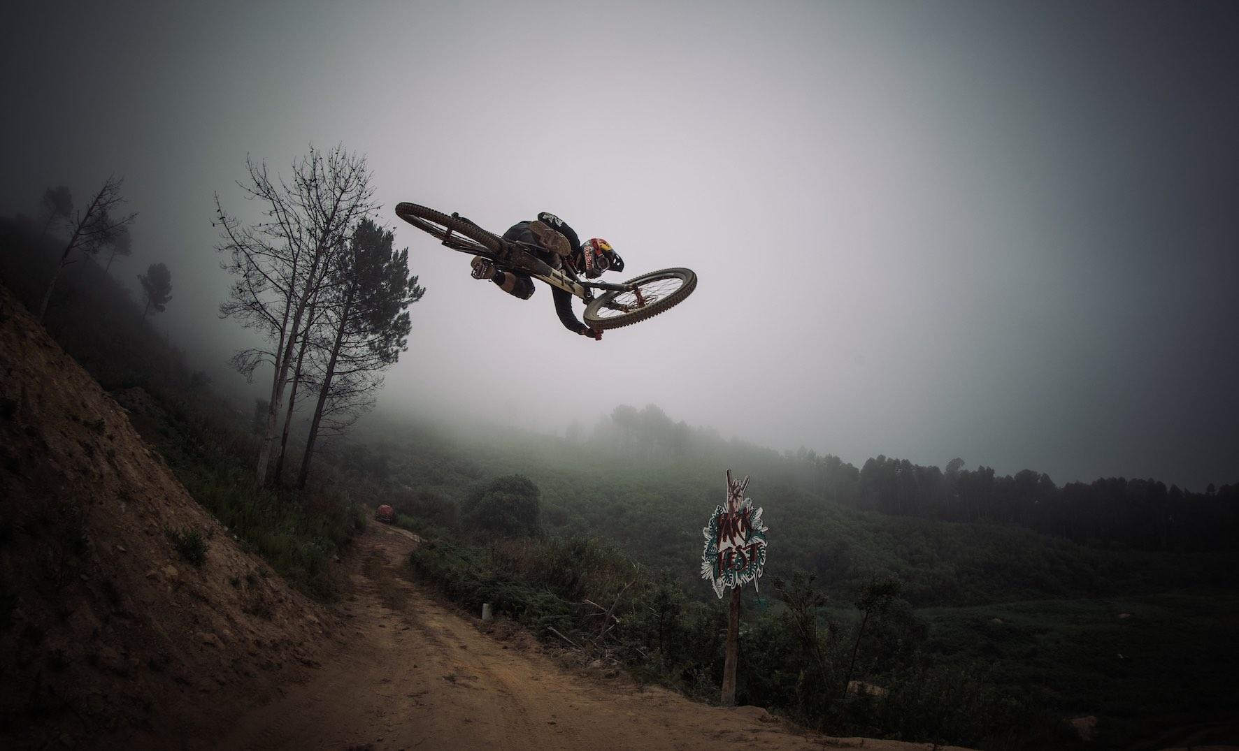Andreu Lacondeguy riding the 2019 DarkFEST Freeride Mountain Bike course