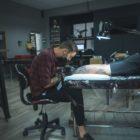 John Martin Viljoen tattooing a client at Awhe Tattoo and Lifestyle Studio