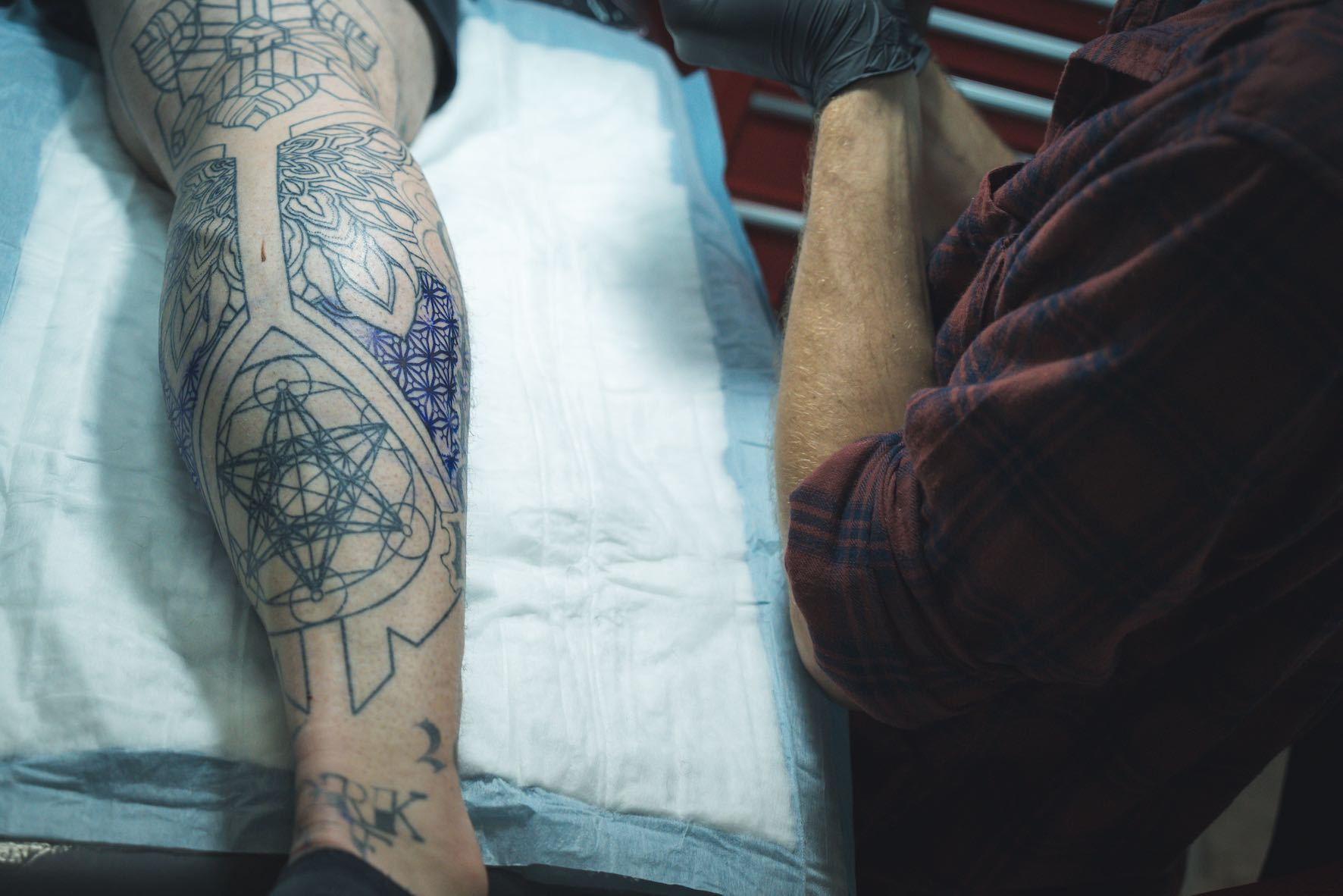 John Martin Viljoen about to tattoo one of his clients