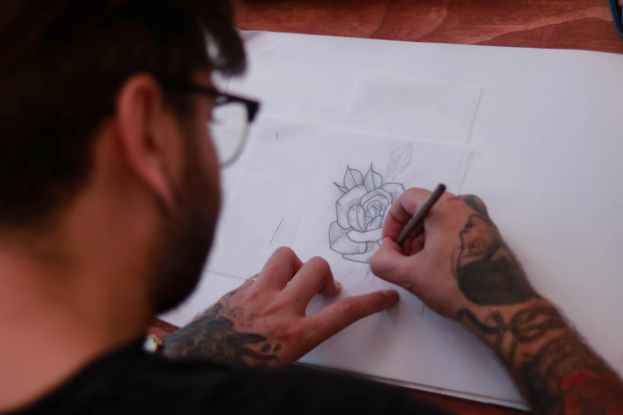 Mason Murdey designing a tattoo for a client