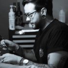 Mason Murdey tattooing a client at Tried and True Tattoos