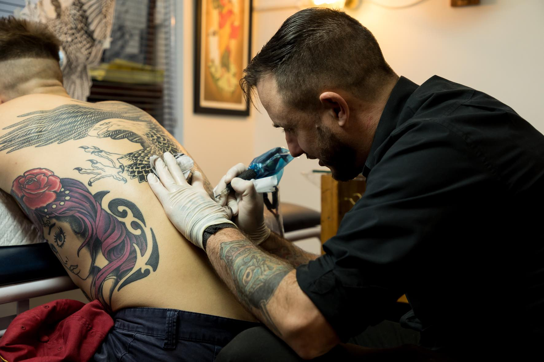 Tyler B. Murphy of Sins of Style in Cape Town tattooing in client