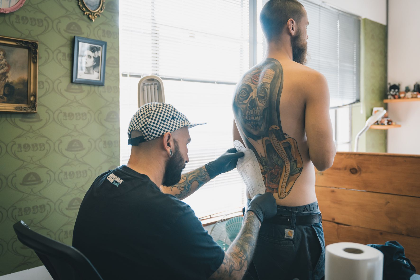 Ronald Jacobs preparing to tattoo a client