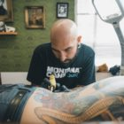 Ronald Jacobs hard at work tattooing a client