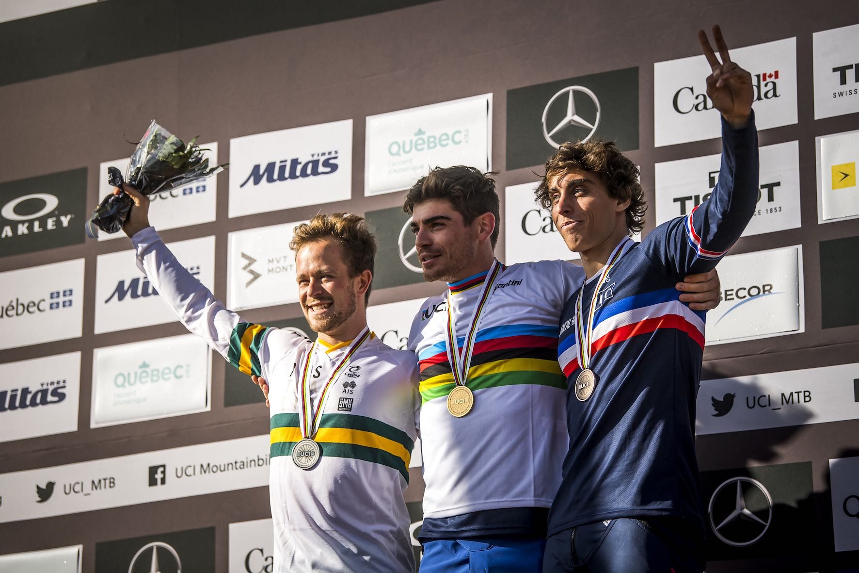 Mens podium from the 2019 UCI Downhill MTB World Championship in Mont-Sainte-Anne