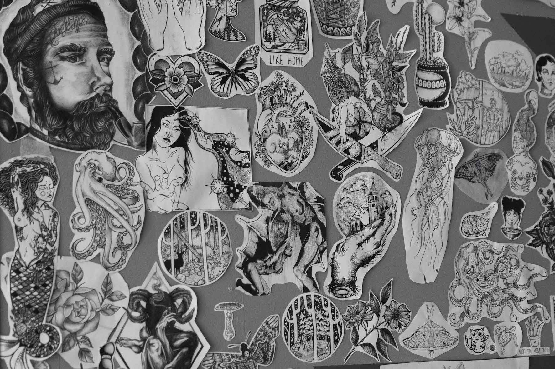 A wall of tattoo templates in Obsidian Black Tattoos