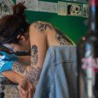 Kat Richter tattooing a client