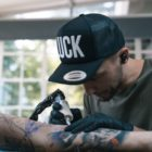 Bryan Du Rand tattooing out of Fallen Heroes