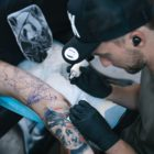 Bryan Du Rand tattooing a client at the Fallen Heroes tattoo studio