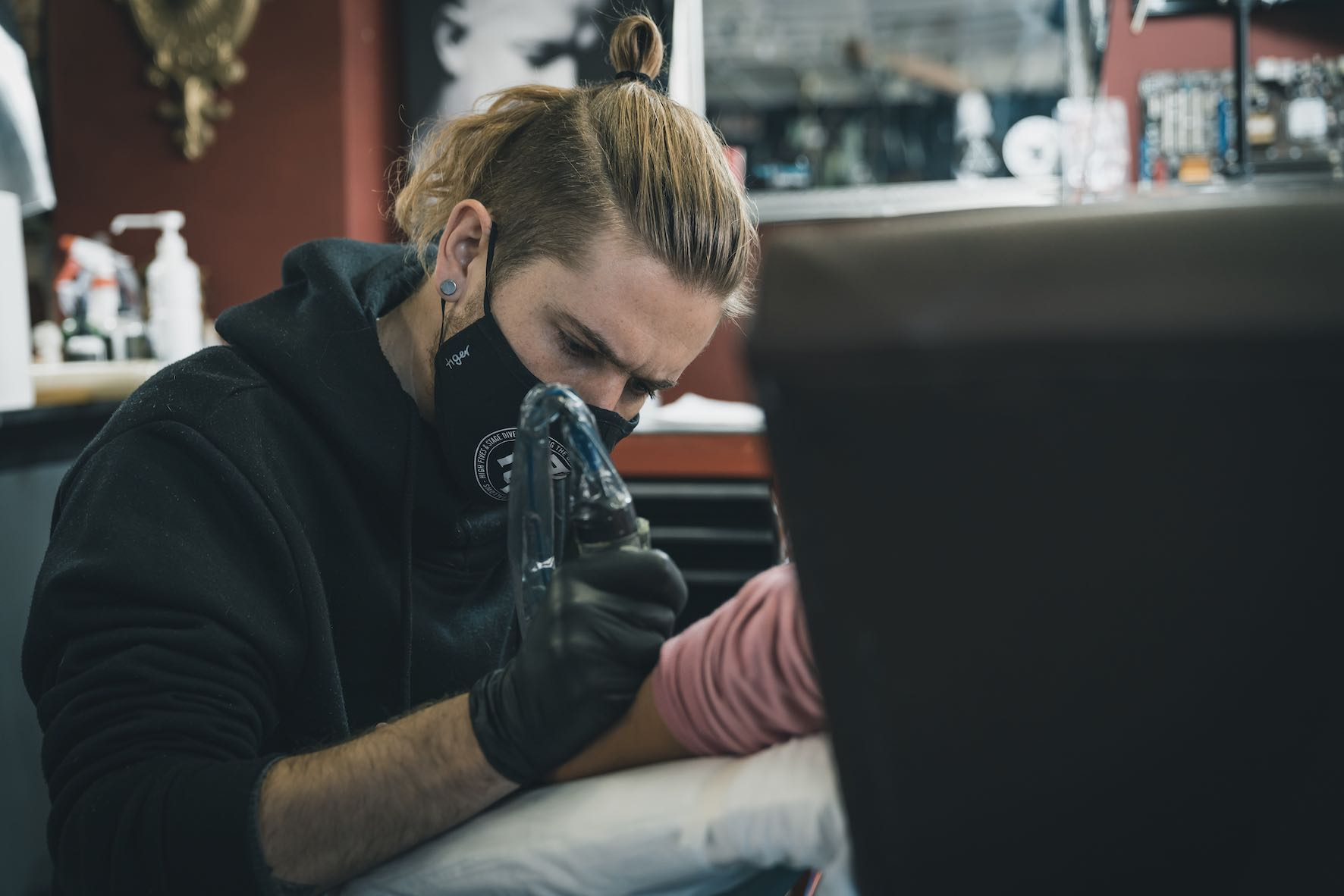 Tattoo Artist Nathan Ferreira working on a client at Ting's Tattoo studio