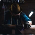 Daniel Feinberg tattooing a client at Heart and Hand tattoos