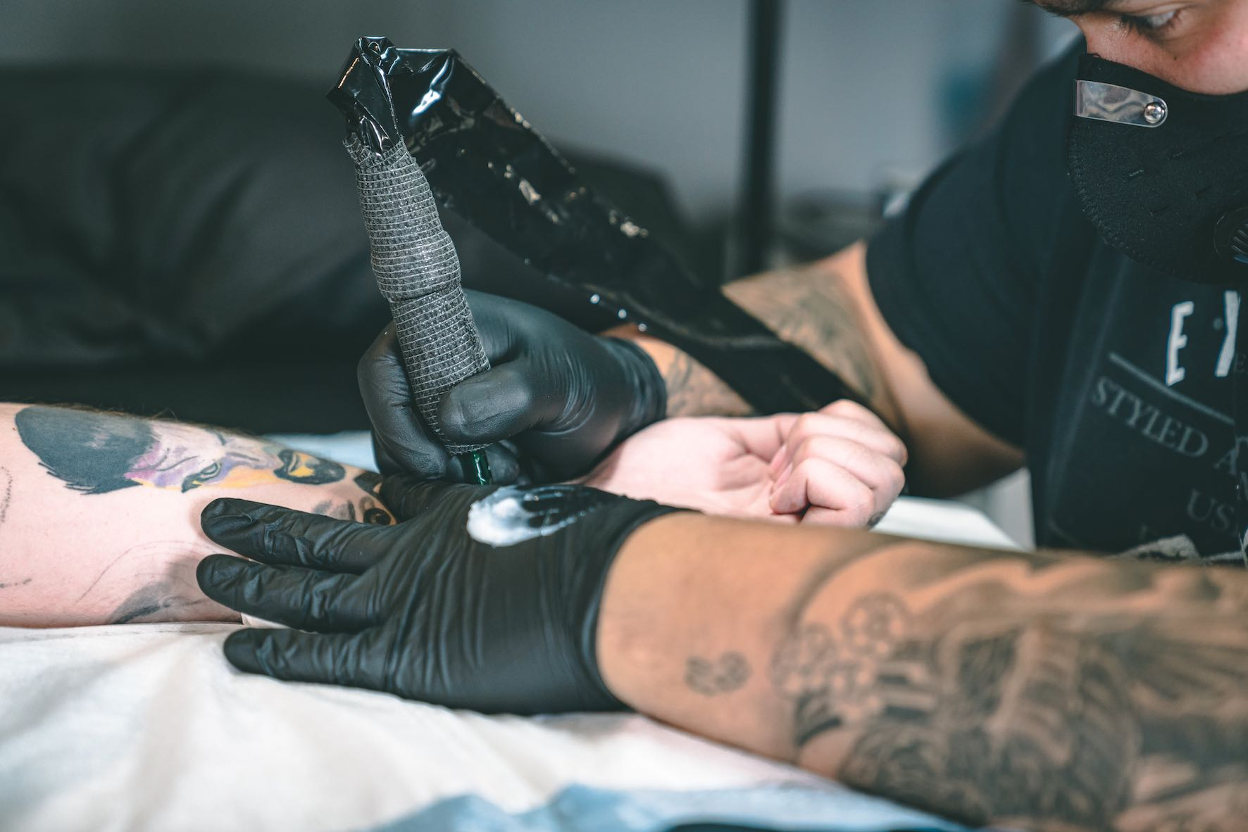 Michael Palmer tattooing a client at Heart & Hand Tattoos
