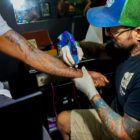 Jake de Gaye tattooing at his tattoo shop in Durban