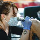 Tarryn Faye Brummage tattooing a client at Ting's Tattoo Studio