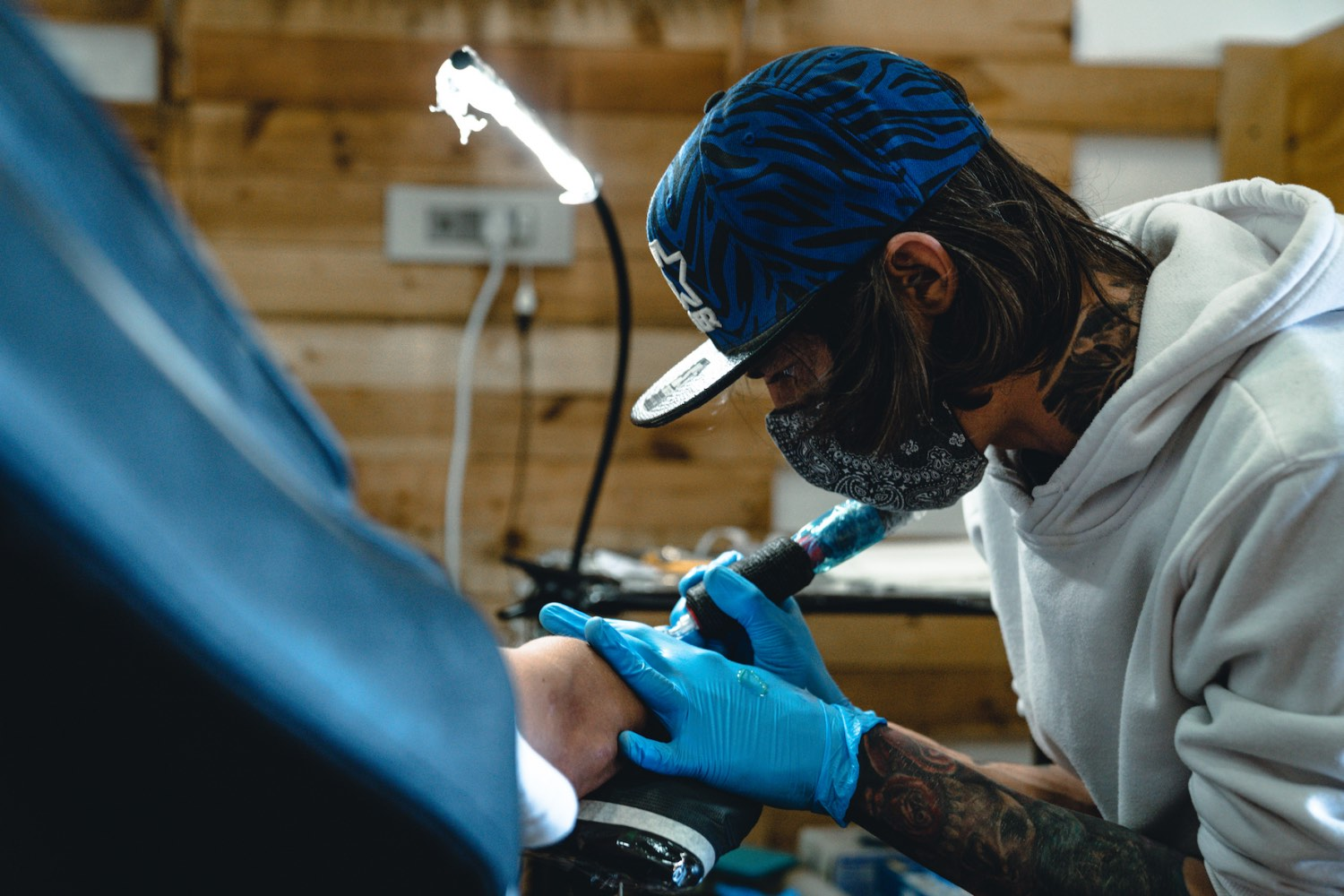 James Rype tattooing a client