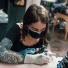 Bianca Uyttenhoven tattooing a client at Handstyle Tattoos
