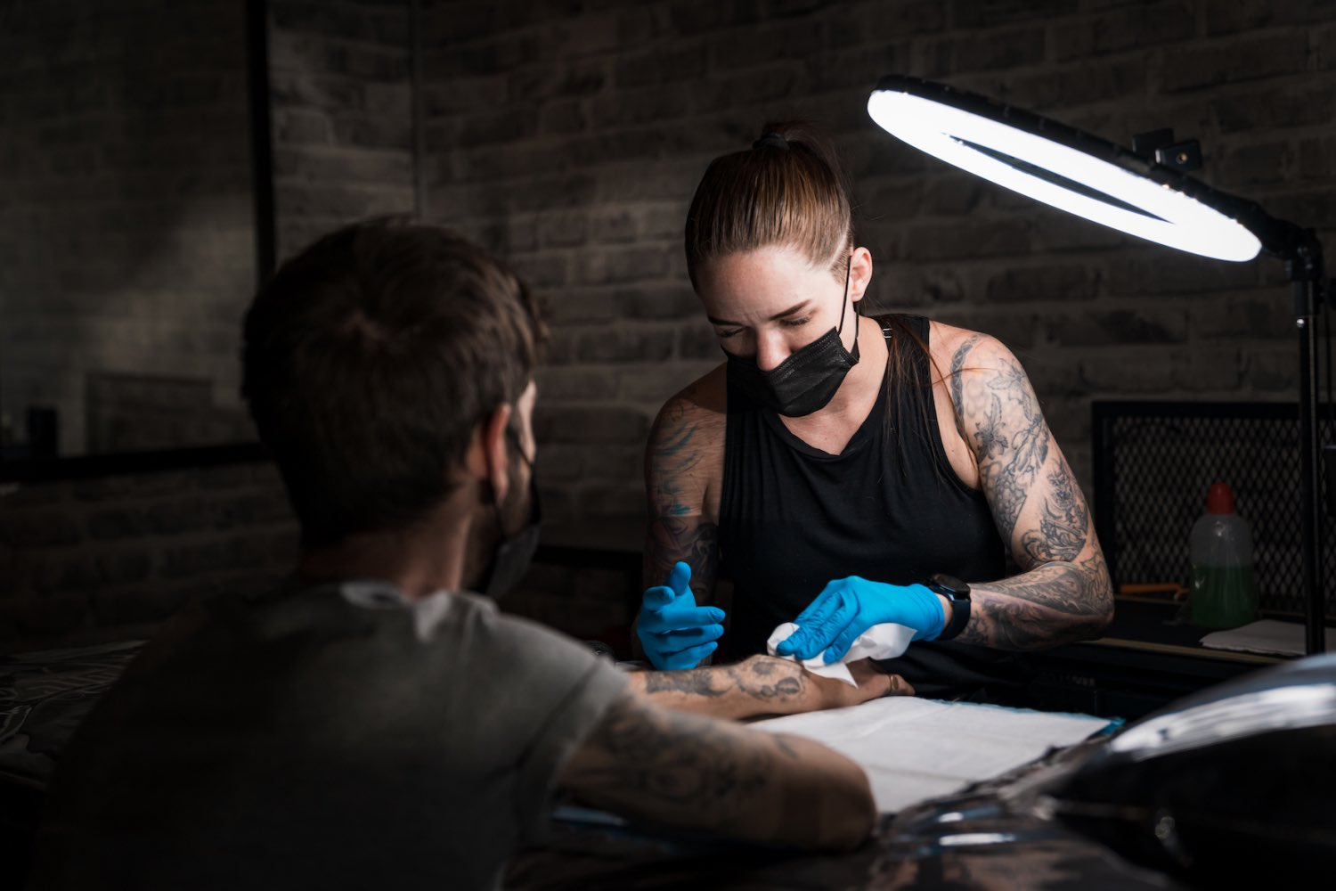 Tory Sutherland-Dadds getting ready to tattoo a client