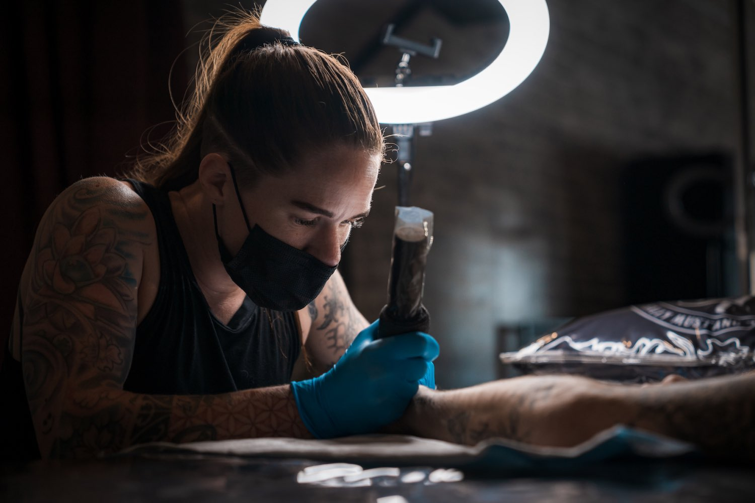 Tory Sutherland-Dadds tattooing a client at Sally Mustang Tattoos